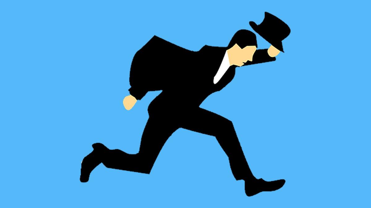スーツで走る人