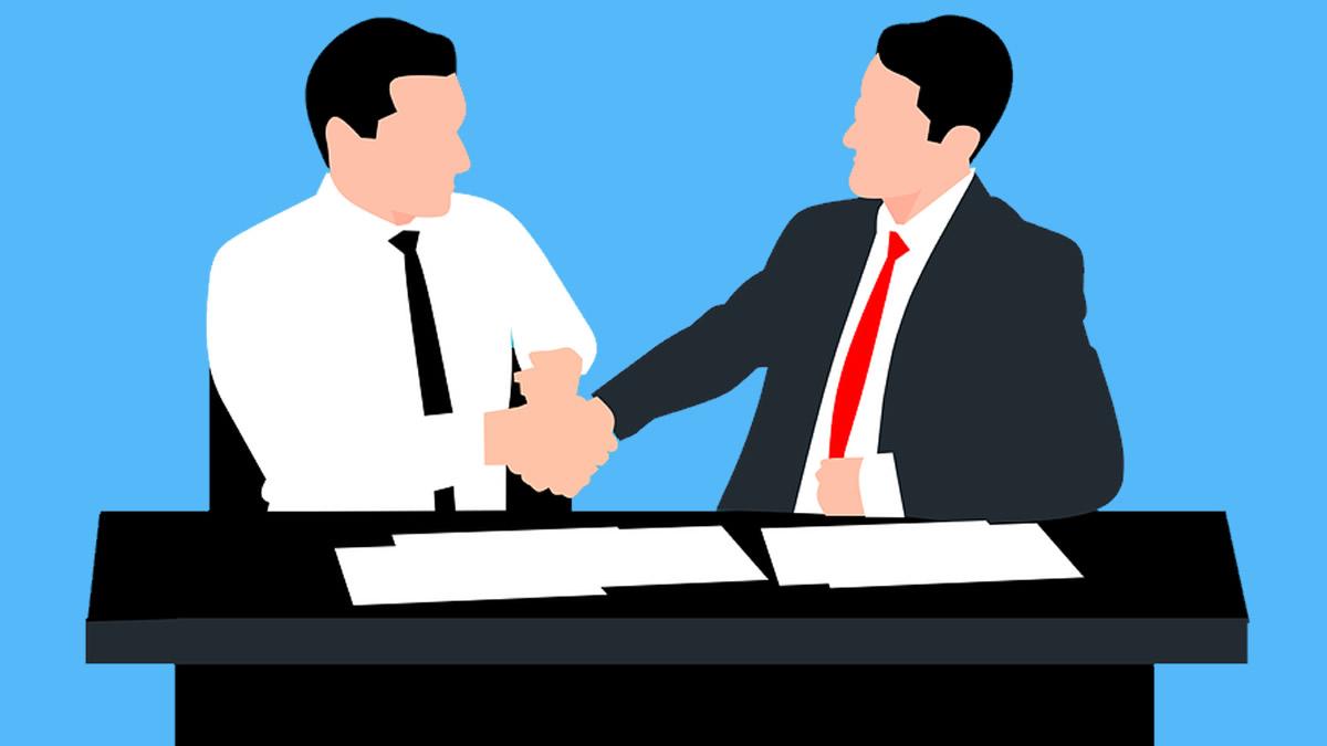 握手する会社の人
